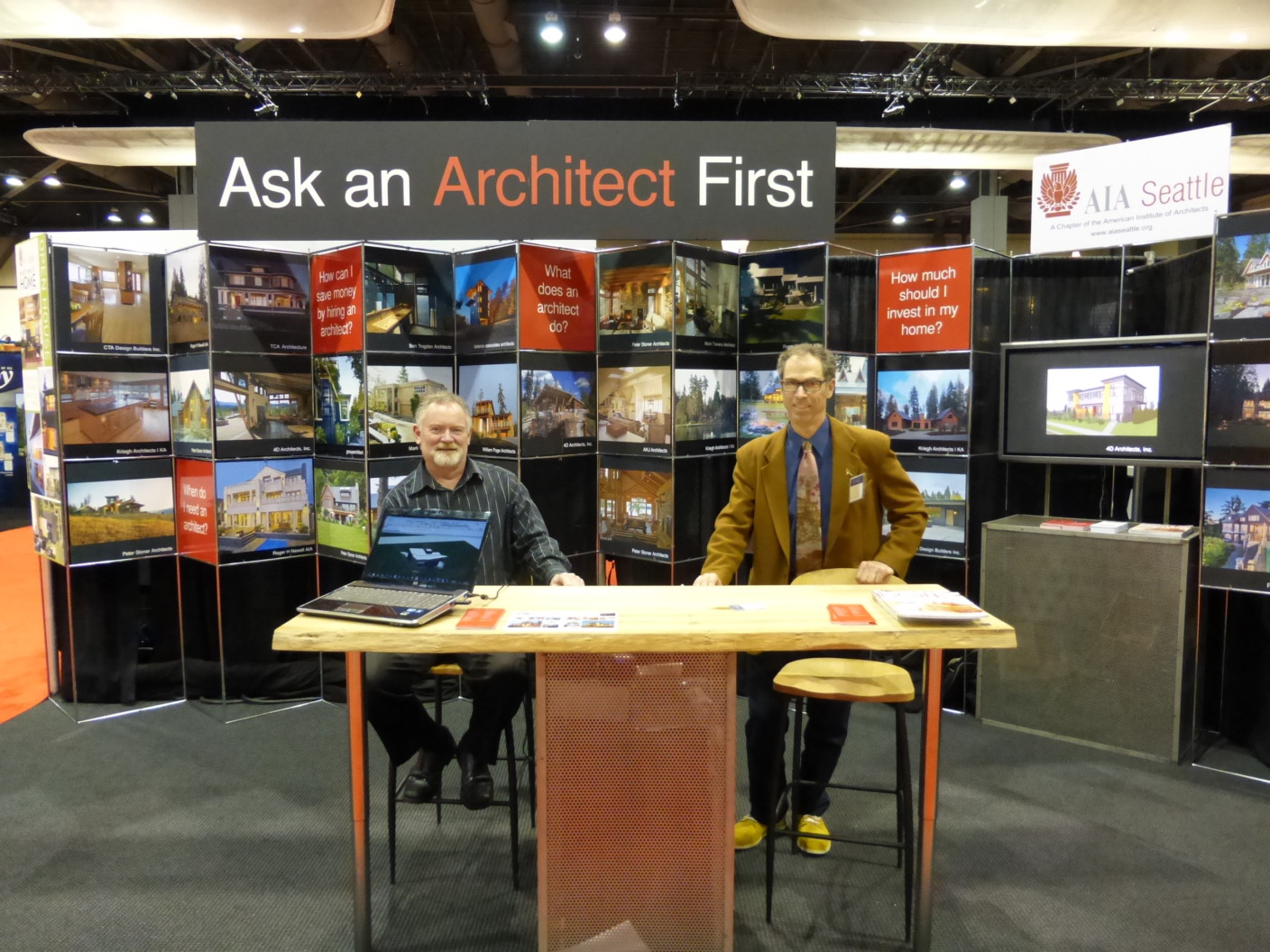 William Page and Joseph Mucci staff the 2014 AIA Seattle booth at the 2014 Home Show